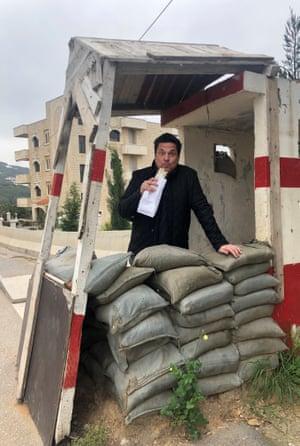 Dom Joly enjoys a manakish at a roadblock in Lebanon.