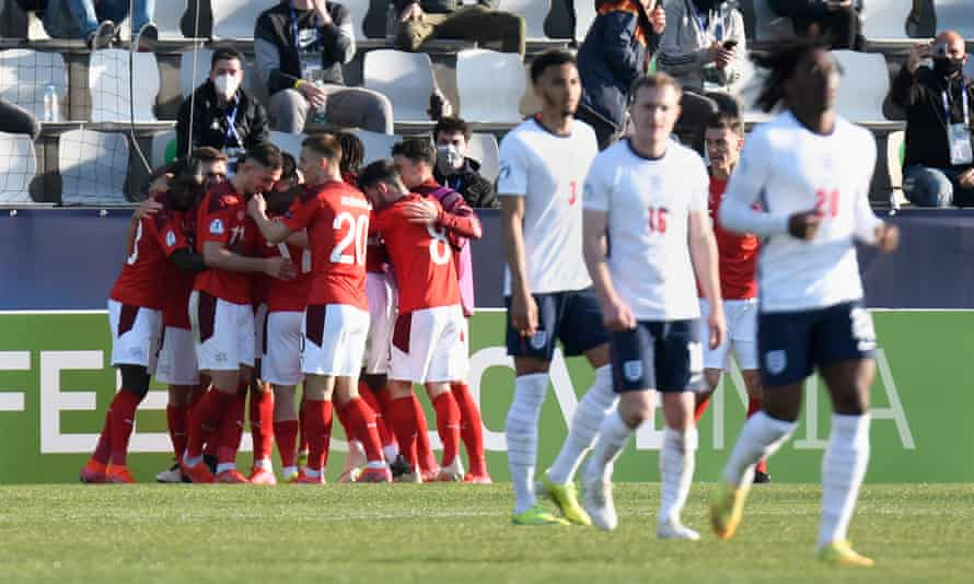England player look away as Switzerland celebrate the Dan Ndoye goal that won them the game in Slovenia.