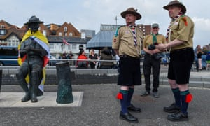 Scouts show their support next to the Baden-Powell statue in Poole