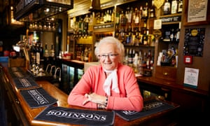 June Hallworth at the Davenport Arms in Woodford, Stockport, where she has been serving pints since 1957.