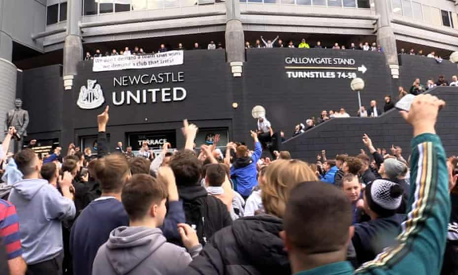 Newcastle fans celebrate confirmation of the takeover