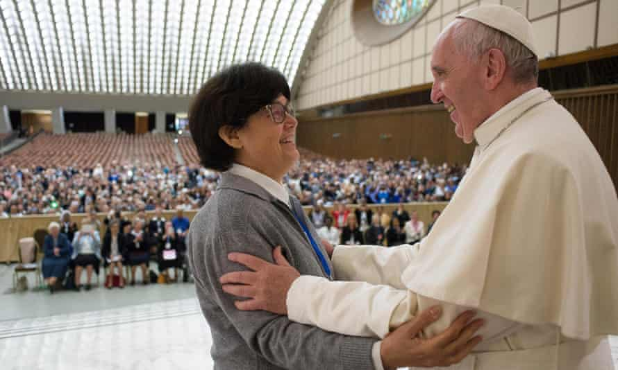 Pope Francis hugs Sister Carmen Sammut, a Missionary Sister of Our Lady of Africa at the end of a special audience with members of the International Union of Superiors General in the Paul VI Hall at the Vatican.