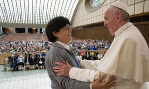 Pope Francis greets a missionary sister at a conference in the Vatican on Thursday