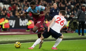 Jeremy Ngakia takes on Liverpool's Andrew Robertson on his West Ham debut.