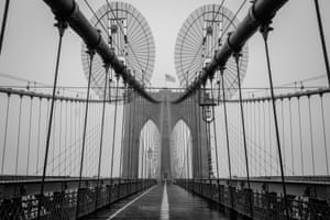 The Brooklyn Bridge deserted at 4pm in Brooklyn, New York on 29 March 2020.