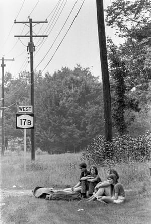 Woodstock Music & Art FairA group of young women sit on the grass next to the 17B West Road at the Woodstock Music & Art Fair, Bethel, NY, August 15, 1969.