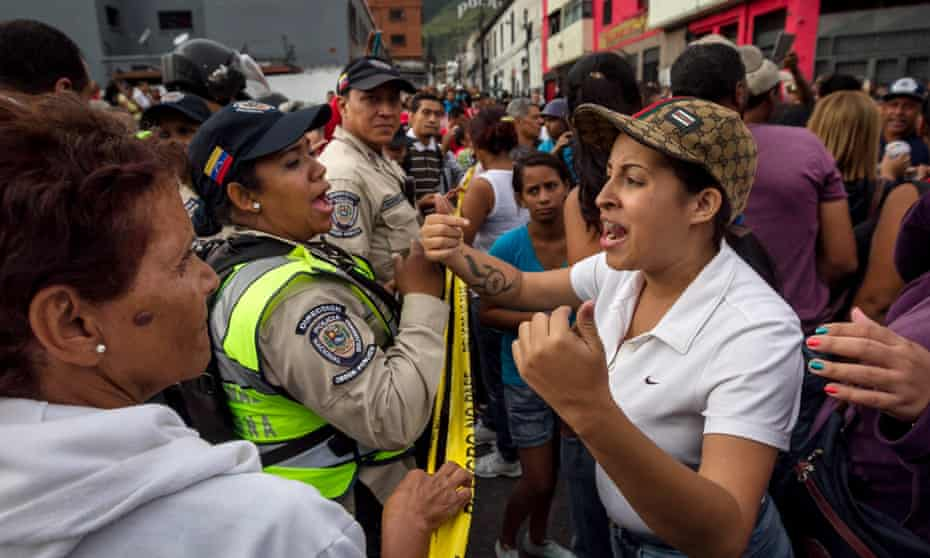 Venezuelans protest on the streets asking for food in Caracas on Wednesday.