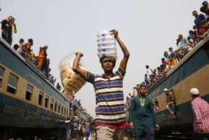 A vendor displays his wares at train station during the final prayer meeting of Bishwa Ijtema, the world congregation of Muslims in Tongi, Bangladesh