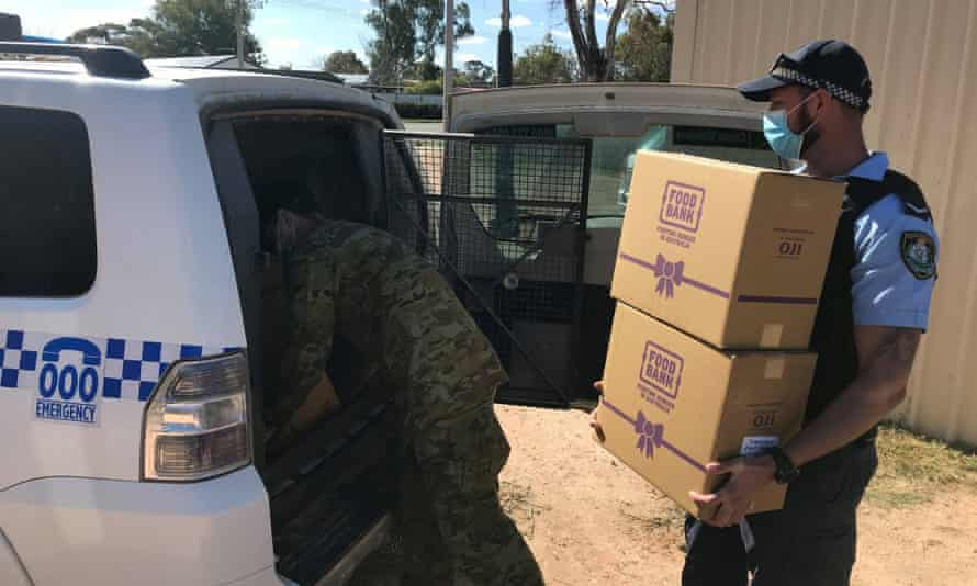 Wilcannia police and soldiers prepare a food run for people in Wilcannia.