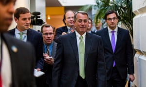 The House speaker, John Boehner, walks to a Republican meeting in the US Capitol to discuss a possible budget deal on Monday.