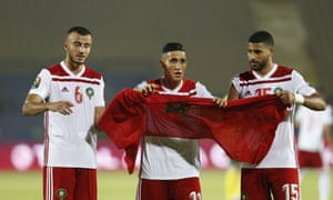 The Moroccan players celebrate after the match.