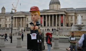 The giant replica of Trump on a gold toilet on display in Trafalgar Square