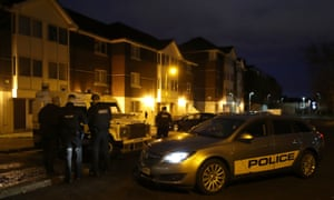 PSNI officers at Kinnaird Close in Belfast, after the bodies of the two victims were discovered.