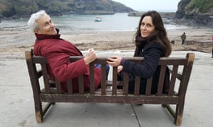 Michael Thomas, Archie's father, and Emily, Archie's sister, on the restored bench in the harbour at Port Isaac in Cornwall.