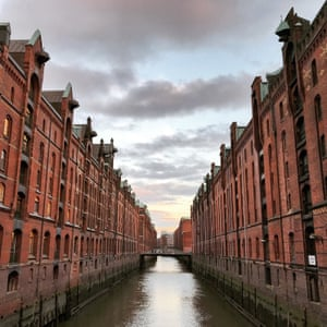 A canal cuts through red-brick Speicherstadt, the world's largest warehouse district, built in the 19th century