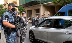 Lebanese policemen check vehicles license plates at a checkpoint in Beirut last month.