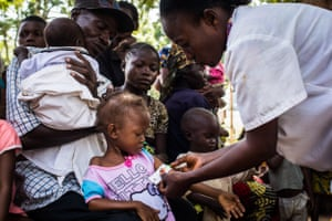 Children are screened for malnutrition at Saint Martyr health clinic in the Congolese city of Kananga