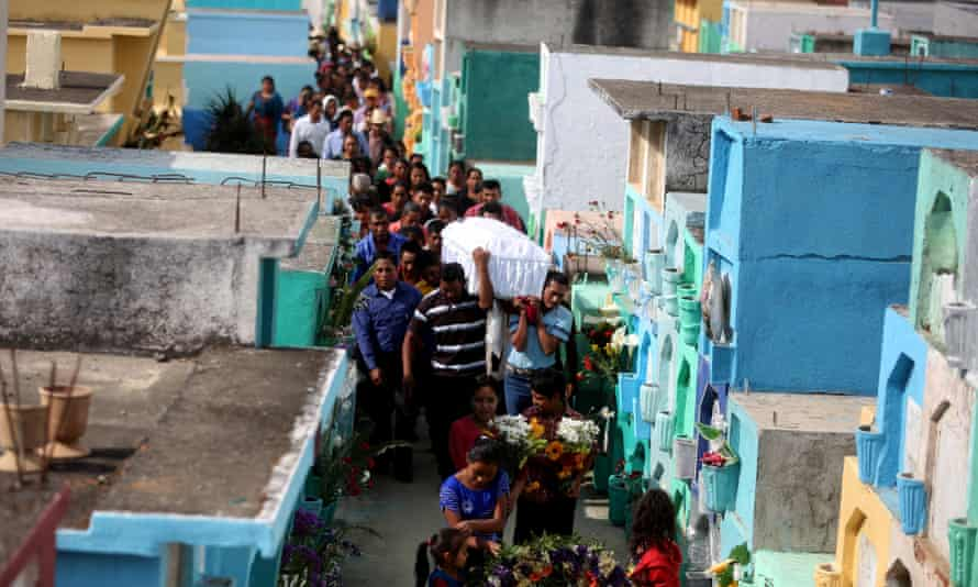 Neighbours and relatives carry the coffin of Roselia Perez Junay, one of the victims of the fire.