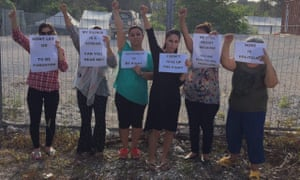 Iranian asylum seekers currently in Nauru detention centre hold up feminist signs