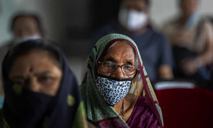Indians wait to receive the Covid-19 vaccine at a private hospital in Gauhati