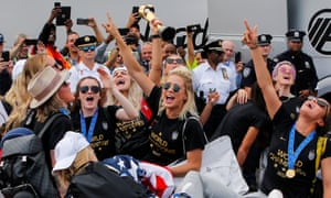 The world champions celebrate as they arrive home from France.
