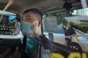 Tong Ying-kit, the first person to be charged under Hong Kong's national security law, arrives at a court in a police van.