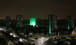 Grenfell and surrounding towers are lit in green