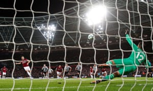 Mark Noble blooters in his penalty kick to double the Hammers' lead.