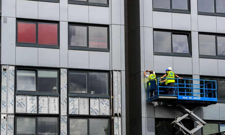 Cladding being removed from Whitebeam Court, in Pendleton, Greater Manchester.