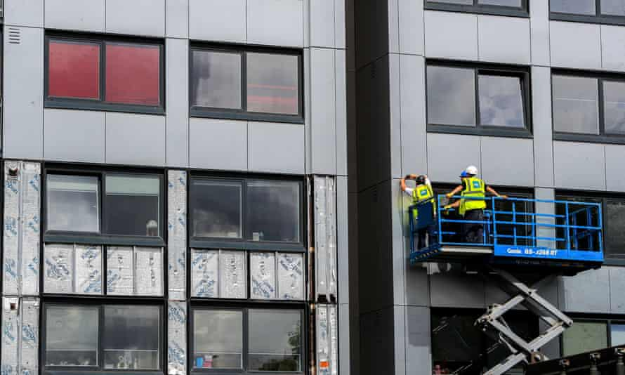 Cladding being removed from a building in Manchester.