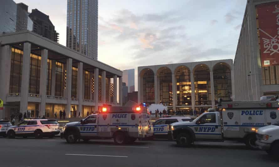 Police responded to New York's Metropolitan Opera which halted a performance after someone sprinkled an unknown powder into the orchestra pit.