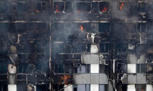 Flames and smoke engulf Grenfell Tower.