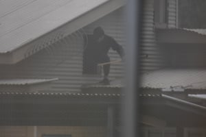 Detainees seen on the roof on Monday morning. The riot broke out on Sunday night.