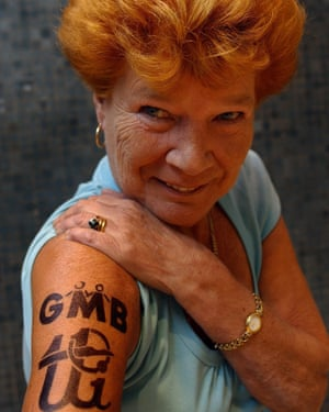 Mary Turner showing off a temporary tattoo to mark the tattoo and piercing industry's union joining the GMB.