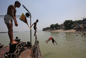Kolkata, IndiaBoys dive into the Ganges on a humid day