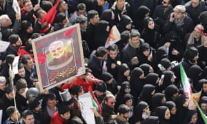 Mourners attend a funeral ceremony in Tehran for Qassem Suleimani