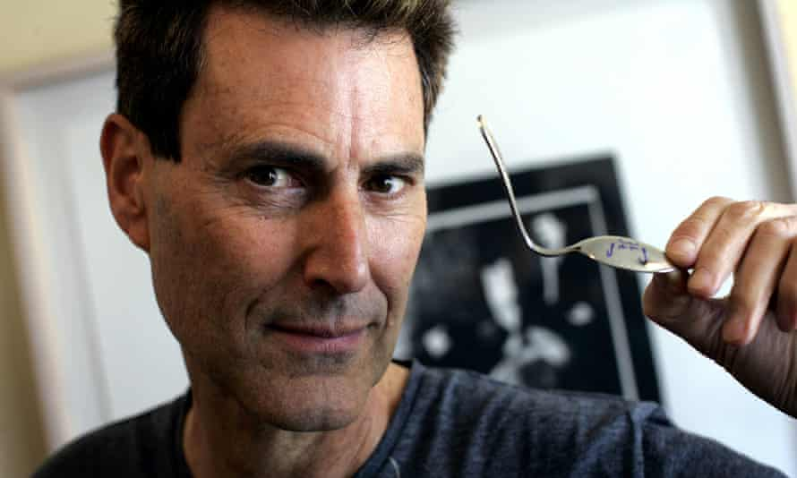 Uri Geller with a spoon he claims to have bent using supernatural powers.