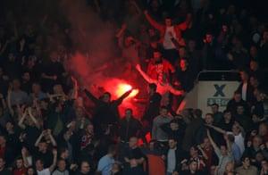 United fans celebrate their third goal.