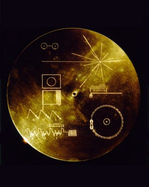 The Voyagers carry aa phonograph record, a 12in gold-plated copper disk containing sounds and images selected to portray the diversity of life and culture on Earth