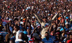 People hold up their hands during a political rally for Ukawa, a coalition of four main opposition parties, in Dar es Salaam, Tanzania, on August 29, 2015