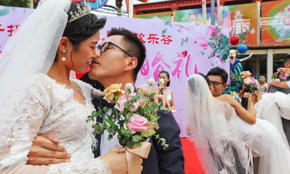 a group wedding held at the Happy Valley amusement park in Shanghai, China