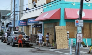 Workers board up shops in preparation for Hurricane Florence in Wrightsville Beach, North Carolina, on 11 September.