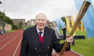 Roger Bannister carries the Olympic torch along the Iffley Road running track (now named after him) in 2012.