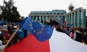 People wave EU and Polish flags during a protest against supreme court legislation in Warsaw (Photograph: Reuters/Kacper Pempel)