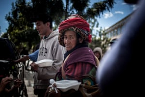 Bogota, Colombia Homeless people receive food from volunteers in Bogota