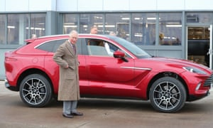 Prince Charles, Prince of Wales, admiring Aston Martin's first SUV, the Aston Martin DBX, at its Lagonda factory in St Athan, Wales, in February