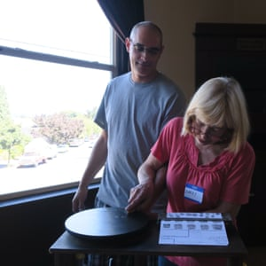 Amber Rogers' husband Brian having his fingerprints taken for his application to expunge his criminal record for growing marijuana.