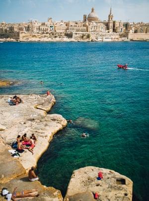 Views sweep across saturated-blue Mediterranean Sea under periwinkle skies