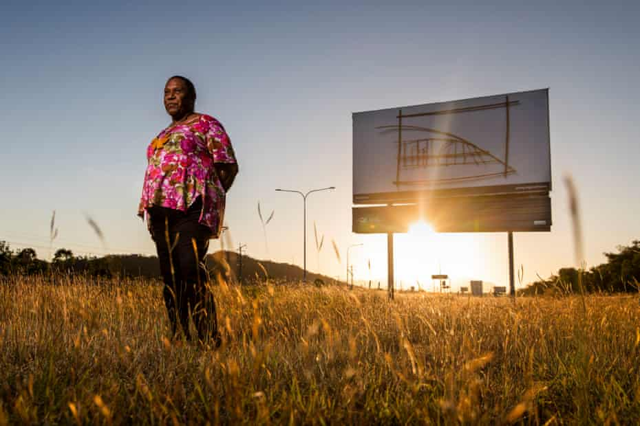 Gail Mabo in front of her Mabo Claim I billboard on the Bruce Highway in Deeragun