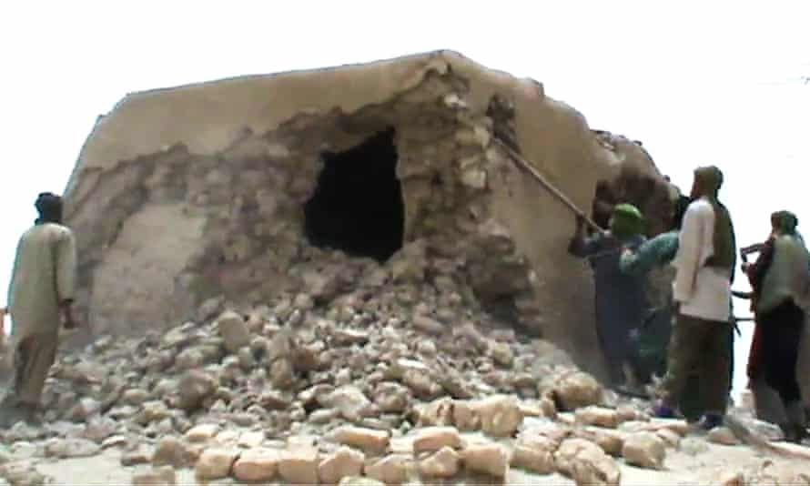 A screengrab of video footage showing militants destroying one of the mausoleums in Timbuktu in 2012.